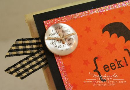 Stamped button closeup