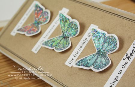 Glittered butterflies laying down